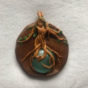 Hand made one of a kind lady of the wood amulet.